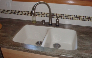 Kitchen sink with earth tone marble